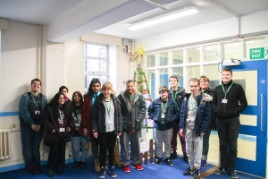 Supported Learning students on the Lifeskills course at RuTC showing off their Christmas Tree