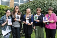 L-R. Grateful International Baccalaureate student, Jordan Graham, displays her free book alongside College staff members and World Book Day givers Cait Orton, Melanie Jones, Patricia Nicholls and Helen Berry.